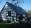 Neubau eines Fachwerkgiebels aus Lärchen-Konstruktionsvollholz